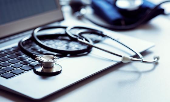 stina healthcare analysis tethoscope on laptop keyboard